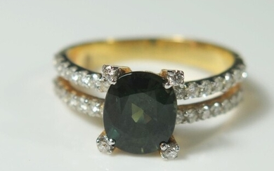 A Green Sapphire and Diamond Ring in an unmarked gold settin...