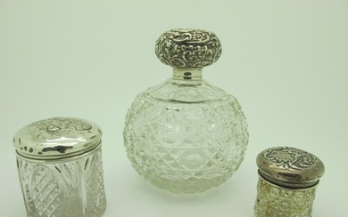 A Large Hallmarked Silver Topped Globular Glass Scent Bottle...