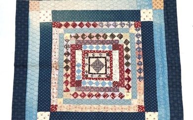 A Large Late 19th Century Quilt, worked in frames and...