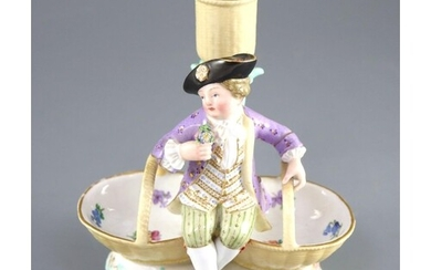 A Meissen figural candlestick, 19th century, in the form of ...
