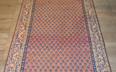 A PERSIAN MIR SERABAND HALL RUNNER. 100% WOOL PILE. HAND-KNOTTED & WITH TRADITIONAL DESIGN OF ALL-OVER PAISLEY PATTERNS SET WITHIN A...