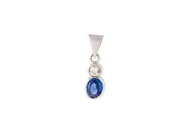 A SAPPHIRE AND DIAMOND PENDANT, the oval sapphire and brilli...