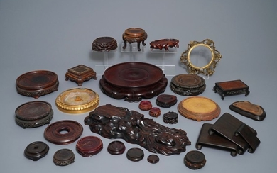 A collection of Chinese stands in carved wood...