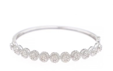 A diamond bangle set with numerous brilliant-cut diamonds weighing a total of app. 1.79 ct., mounted in 18k white gold. Diam. app. 5.6×4.8 cm.