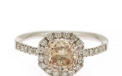 A diamond ring set with a radiant-cut natural orangy yellowish brown diamond weighing 1.35 ct., and diamonds weighing 0.26 ct., mounted in 18k white gold.