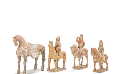 A group of pottery horses and equestrians