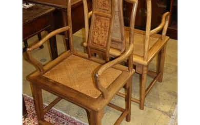 A pair of Chinese Ming style hardwood elbow chairs, with can...