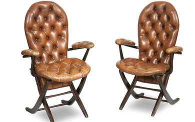 A pair of French 1960's Poly-X Polyconfort mahogany and leather folding chairs
