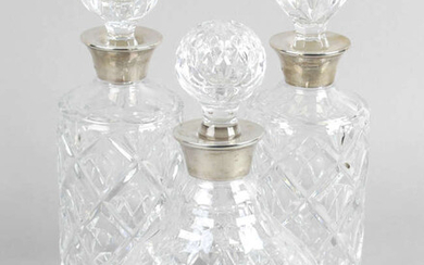 A pair of cut glass decanters and stoppers.