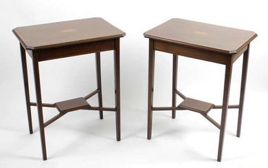A pair of early twentieth century mahogany side tables, raised upon square block tapered supports.