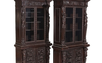 A pair of late 19th century stained wood Neo Renaissance library's cabinets, richly carved with figures, flowers and foliage. H. 209. W. 107. D. 47 cm. (2)