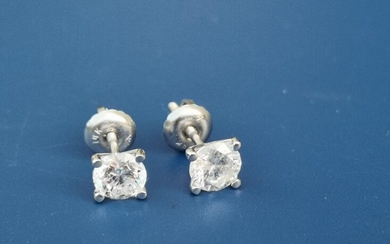 A pair of modern diamond stud earrings, the four-claw...