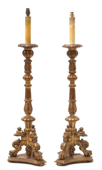 A pair of modern giltwood standard lamps in the form of candlesticks