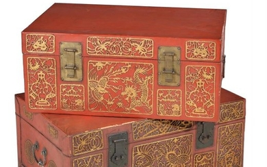 A pair of red lacquered and parcel gilt leather trunks