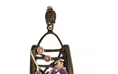 A pendant set with a fancy-cut amethyst and three cabochon rhodolite garnets, mounted in black rhodium plated and partly gilded sterling silver. L. app. 4.9 cm.