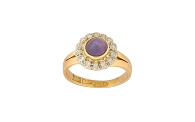 A purple star sapphire and diamond cluster ring