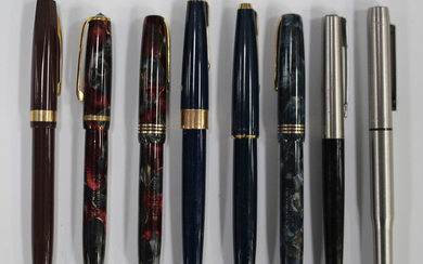 A quantity of fountain and roller ball pens, including four Burnham fountain pens and various Parker
