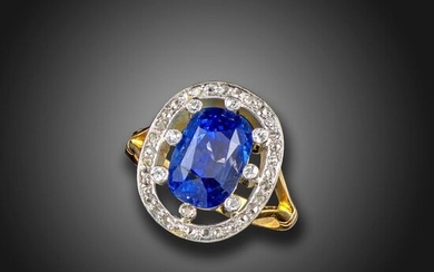 A sapphire and diamond cluster ring, the cushion-shaped sapphire weighs...