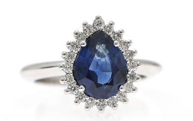 NOT SOLD. A sapphire and diamond ring set with a pear-shaped sapphire encircled by diamonds,...