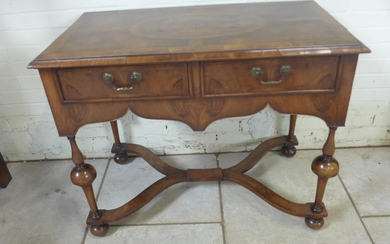 A walnut two drawer Queen Anne style side table, the top qua...