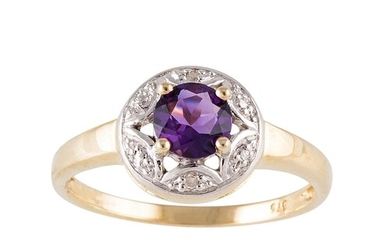 AN AMETHYST RING, set with diamond points, mounted in 9ct ye...