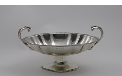 AN EARLY 19TH CENTURY TWO-HANDLED FRUIT DISH on a shap-ed ov...