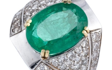 AN EMERALD AND DIAMOND COCKTAIL RING; featuring an oval cut emerald of approx. 5.3ct, to tapering shoulders set with 58 round brilli...
