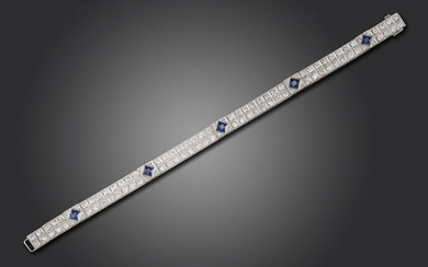 An Art Deco sapphire and diamond bracelet, set with pairs of old circular-cut diamonds millegrain set in square collets, separated with five French-cut sapphires, in platinum, 18cm long, case