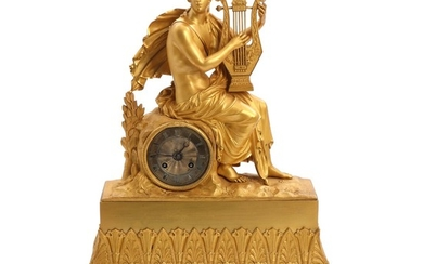 An early 19th century French gilt bronze mantle clock, decorated with a young man in classical robe, silvered dial with black Roman numerals. H. 51 cm.