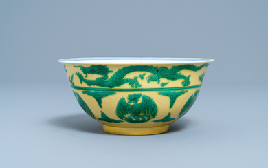 An imperial Chinese green and yellow enamelled 'dragon and phoenix' bowl, Kangxi mark and of the period