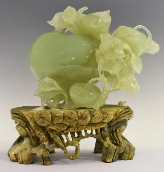 CHINESE CARVED SERPENTINE JADE PEACH ON STAND