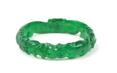 Chinese green jade bangle carved with a dragon, 7.5cm