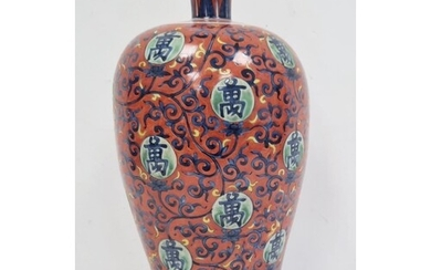 Chinese vase of ovoid form, decorated with blue trailing spa...