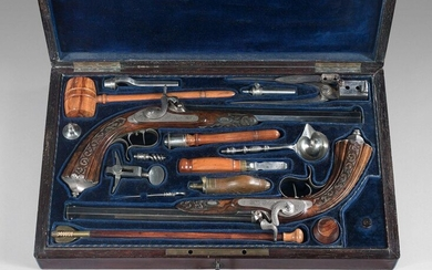 """Box containing a pair of percussion pistols by Lepage Moutier: blued octagonal barrels signed on the upper sides: """"Lepage Moutier arqer à Paris""""; calibre 12 mm, rifled; front plates engraved with foliage and rinceaux, double stecher trigger tail; iron..."""