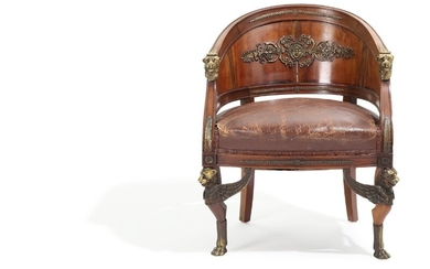 """""""Fauteuil gondole"""". A French 19th century bronze mounted mahogany Empire style armchair. Richly decorated with lions and foliage."""