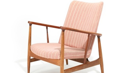 "Finn Juhl: ""SW 86"". Armchair with oak frame and teak armrests, upholstered with light and rose striped wool. Manufactured by Søren Willadsen."