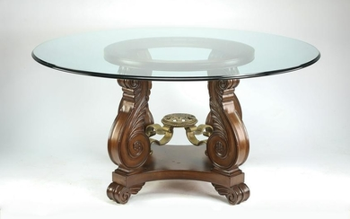 Glass top center table with carved scrolling legs