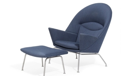 """Hans J. Wegner: """"Oculus Chair"""". Easy chair with stool, stainless steel frame. Upholstered with blue wool. Manufactured by Carl Hansen & Son. (2)"""