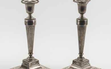 PAIR OF NEOCLASSICAL GEORGE III WEIGHTED STERLING SILVER CANDLESTICKS Removable bobèches Tudor & Leader (Henry Tudor & Thomas Leader...