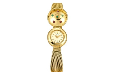 PIAGET | REFERENCE 3325 A YELLOW GOLD AND SAPPHIRE-SET BRACELET WATCH WITH CONCEALED DIAL, CIRCA 1970