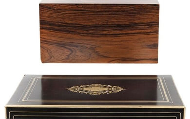 Pair of Cigar Boxes, 20th century, One in carved, polychrome black wood, another in carved DAVIDOFF wood.