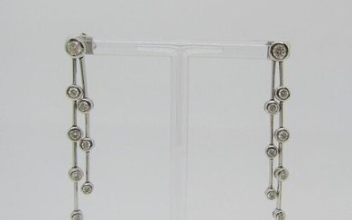 Pair of articulated 18ct white gold drop earrings set with g...