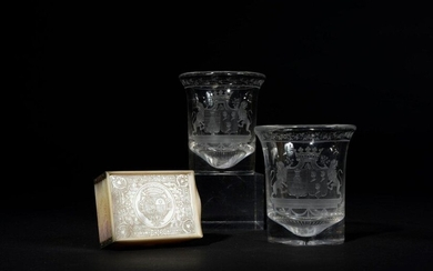 Pair of crystal goblets engraved with a garland of flowers and a wedding band coat of arms stamped with a ducal wreath edged with lions. Charles X period Height 9,5 cm