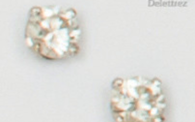 Pair of white gold earrings set with brilliant-cut...