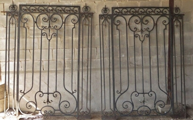 Pair of wrought-iron grills decorated with scrolls and interlacing.