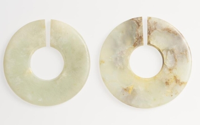 TWO CHINESE NEPHRITE JADE 'JUE' SLIT-RINGS EASTERN ZHOU (770-256 BC) OR HAN DYNASTY (202 BC-220 AD)