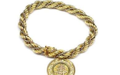 Two tone 18ct gold rope twist bracelet and tests as 9ct gold...