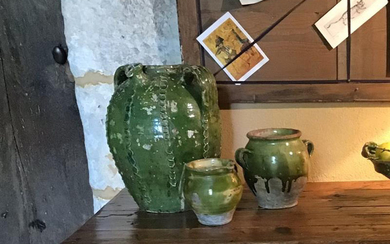 White earthenware oil jug with green glaze. Ovoid...