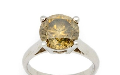 White gold ring with a solitaire golden yellow diamond weighing 4.03 cts