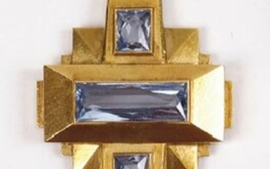 Yellow gold cross decorated with four aquamarines.